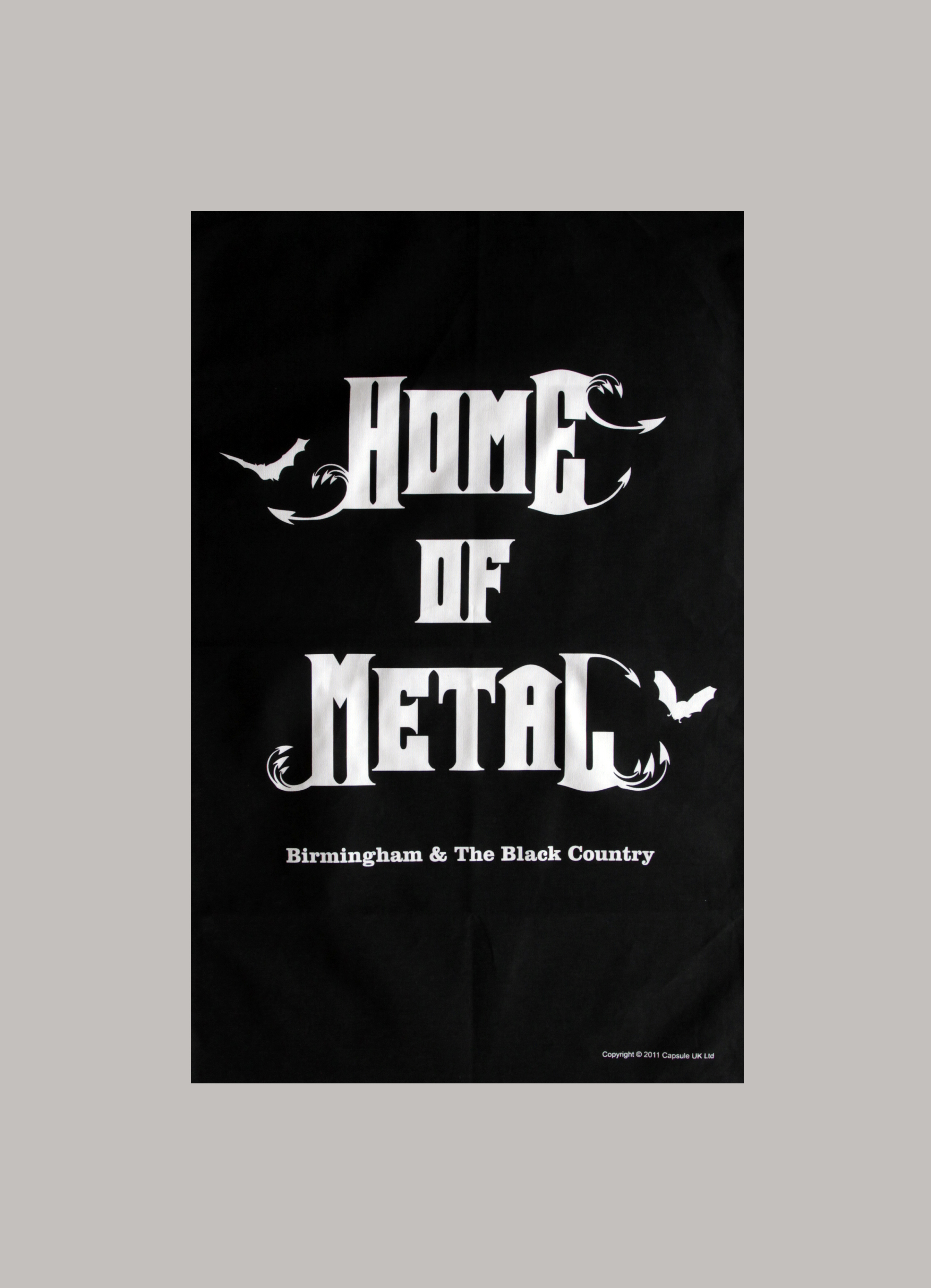 Home of Metal tea towel